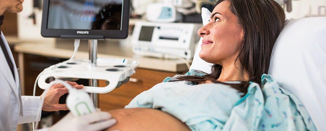 Nurse using portable ultrasound machine